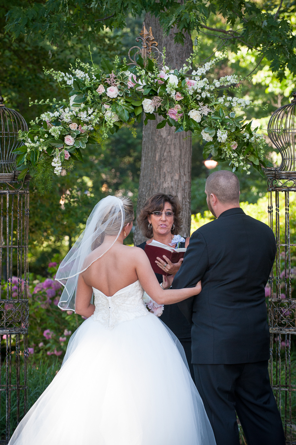 Wedding ceremony on state House grounds with floral arbor