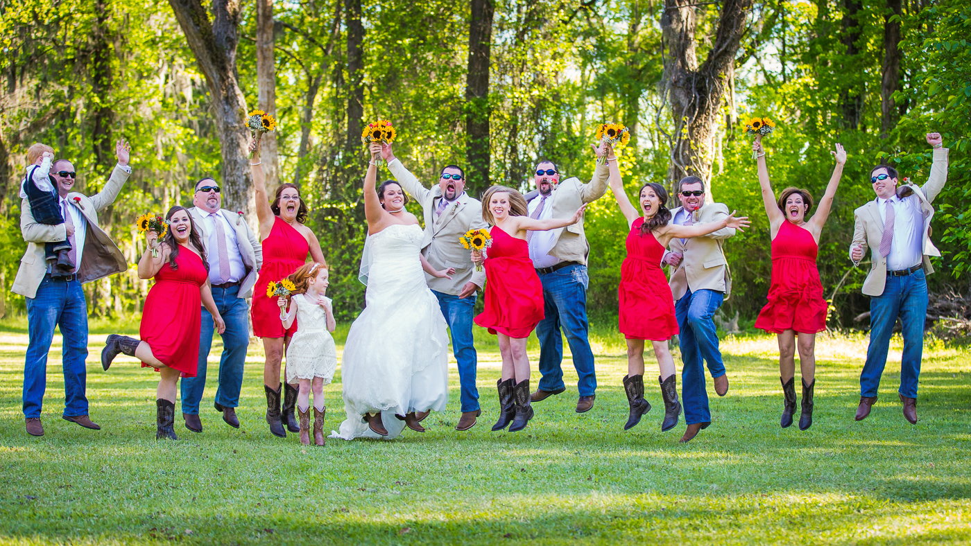 Jumping bridal party photo at Adam's Pond
