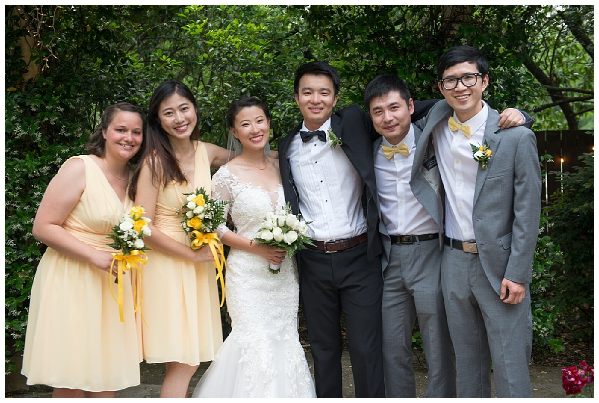 Wedding party in yellow dresses and grey suits