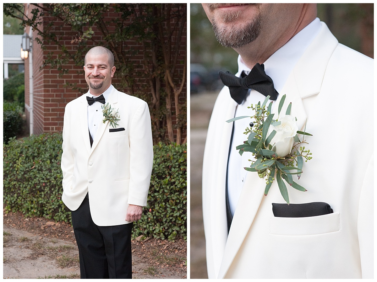 Groom with white jacket and boutineer