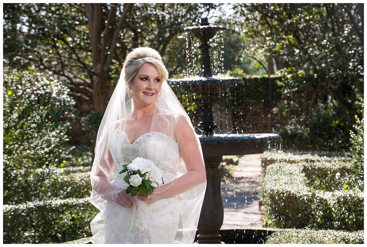 Bride by a fountain at the Lace House